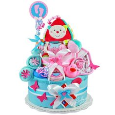 2 Tier Baby Girl Nappy cake made from Pampers Nappies, toys, burp cloth, washcloth, bib, pacifier, baby socks, bath toy, baby spoon, care and cleaning products (wet wipes, soft cream and shower cream) & decor item
