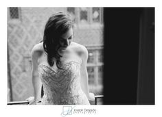 Elegant bridal pose. Black and white photo of a bride at Aldie Mansion.