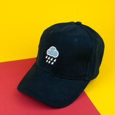 016ecf0867772 Rainy day embroidered baseball cap navy (£16.95) found on HattyHats.com  featuring. Hatty Hats Embroidery
