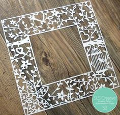 Floral bird cage paper cut frame for a photo
