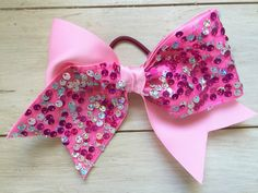 A personal favorite from my Etsy shop https://www.etsy.com/listing/295062421/pink-sequence-large-cheer-bow-sparkle