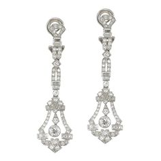 Art Deco Diamond Platinum Drop Earrings | From a unique collection of vintage dangle earrings at https://www.1stdibs.com/jewelry/earrings/dangle-earrings/
