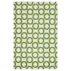 Rug with a links motif.   Product: RugConstruction Material: 100% PolyesterColor: Ivory and peridot