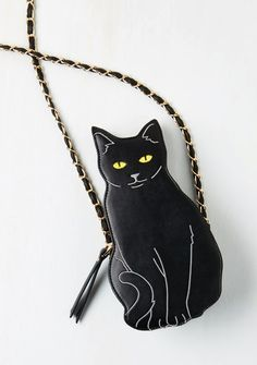 This black cat bag — $39.99 | 17 Super Cute Ways To Get Into The Halloween Spirit Without Wearing A Costume