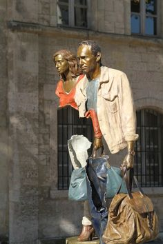 "Bruno Catalano in Marseille: Bruno Catalano is a French artist born in 1960 in Morocco. He is the creator of eye-catching bronze sculptures called ""Les Voyageurs"" - his work is about loss of identity, home and nationality...."