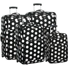 Stylish and sassy, no trip is complete without this Polka Dot 4-piece Luggage Set. This luggage set features oversized white polka dots on a black background. Set includes: 20-inch case, 24-inch case, 28-inch case, 32-inch case. $149.99. Buy here.