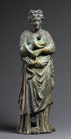An ancient Roman bronze statuette of Hygieia, the goddess of hygiene, with her snake attribute, a symbol of healing. (J Paul Getty Museum)