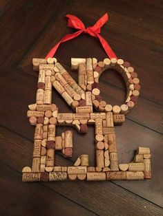 This lovely wall hanging is made from upcycled, hand-cut wine corks. It comes with a red ribbon affixed to the top for easy hanging. It measures This item will make a beautiful addition to your Christmas decor.