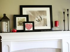 Inspiration for layering framed prints and photographs on a mantel. Don't be afraid to overlap the existing mirror. These are not the prints I'm suggesting for your space; rather, I wanted you to see the idea of leaning and layering frames.