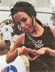 Aaliyah Dana Haughton (January 16, 1979 – August 25, 2001) was an American singer, dancer, actress, and model. She was born in Brooklyn, New York, and raised in Detroit, Michigan.