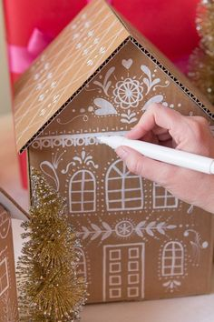 Inspirations et idées pour Noël : DIY Gingerbread house gift boxesDIY Gingerbread house gift boxes - I have to do this next Christmas.DIY gingerbread house gift box created with cardboard and paint markers.These gingerbread house gift boxes are ado Cardboard Gingerbread House, Christmas Gingerbread, Noel Christmas, Gingerbread Houses, Christmas Houses, White Gingerbread House, Cardboard Christmas Tree, Xmas Tree, Christmas Cookies