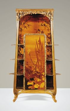LOUIS MAJORELLE: A WALNUT AND FRUITWOOD MARQUETRY CABINET, CIRCA 1900   JV