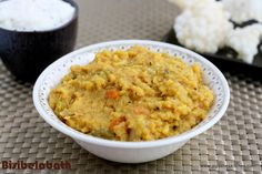 Bisibelabath (Sambar rice). This is a wonderful one pot meal. Just add a simple raita and roasted pappadams to complete the menu. Pappadams roast quite well in a microwave oven.