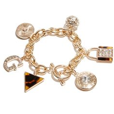 GUESS Sophia Gold-Tone Charm Bracelet ($28) ❤ liked on Polyvore featuring jewelry, bracelets, multi, guess jewelry, gold tone bangles, gold tone jewelry, charm bracelet and goldtone jewelry
