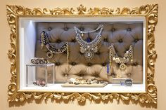 Jewelry store by Marketing Jazz, Madrid store design : The tufted shadow box display is a great DIY.