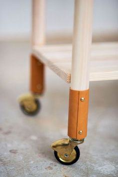 Using leather as a finishing detail is a great and cheap DIY update for old furniture.