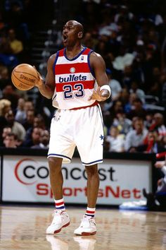 WASHINGTON - APRIL 9: Michael Jordan #23 of the Washington Wizards calls out play during his final NBA game against the Boston Celtics at the MCI Center on April 9, 2003 in Washington D.C. The Celtics won 87-83. The Wizards wore the red and white horizontally striped uniforms of the 1978 Washington Bullets. NOTE TO USER: User expressly acknowledges and agrees that, by downloading and/or using this Photograph, User is consenting to the terms and conditions of the Getty Images License…