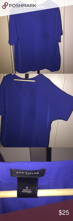 Ann Taylor Short Sleeve V-Neck Silky, beautiful blue top with doleman sleeve v-neck from Ann Taylor. Size medium and so comfortable! 💋 Great for the office or with jeans and boots for fall! 🍁🍂 Perfect condition 👌 and great for any fit. Offers are welcome through the Offer button. Not open to trades. Thanks for looking! Xoxo Amanda Ann Taylor Tops Tees - Short Sleeve
