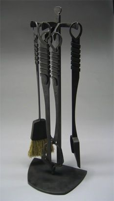 Hand forged iron fireplace tools by Greg Gehner.