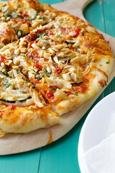 Thai Chicken Pizza - sweet chili sauce base, shredded chicken, chopped peanuts, cilantro, cheese - sigh