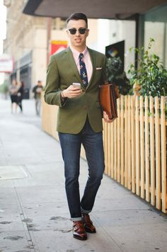 Opt for a dark green blazer and deep blue jeans if you're going for a neat, stylish look. Feeling inventive? Complement your outfit with brown leather double monks. Shop this look for $388: http://lookastic.com/men/looks/dress-shirt-and-pocket-square-and-tie-and-briefcase-and-jeans-and-double-monks-and-blazer/1486 — Pink Dress Shirt — Pink Pocket Square — Navy Floral Tie — Brown Leather Briefcase — Navy Jeans — Brown Leather Double Monks — Dark Green Blazer