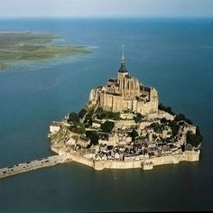 A Town In The Middle Of The Sea......!!!!!!!!  Mont Saint Michel is located in France.Its construction began in 709.In 1874 it was declared a historic monument.The population of Mont Saint Michel is 80 including 50 monks.