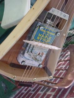 can resonator, plexiglass top; travel guitar