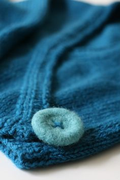 Here is an easy tutorial on making needle felted buttons