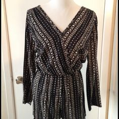 ✨CLEAROUT SALE✨Long sleeve, elastic waist romper Long sleeve tribal print romper, with elastic waist. Deep-v wrap front with button closure. 100% rayon. Worn 1 time! Great condition! Moving in a week and need to clear this out. Accept offers. Lovely day Dresses Mini