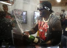 Playoff-clinching celebrations | Sep 20, 2013; Boston, MA, USA; Boston Red Sox player David Ortiz (34) sprays champagne after they won the AL East with a win over the Toronto Blue Jays at Fenway Park. (Winslow Townson-USA TODAY Sports)