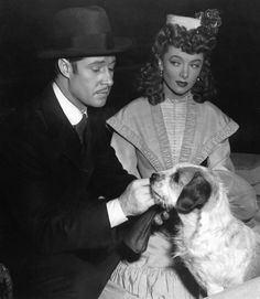 0 Don Ameche and Myrna Loy on set with dog Golden Age Of Hollywood, Hollywood Stars, Classic Hollywood, Old Hollywood, Don Ameche, George Brent, William Powell, Myrna Loy, I Love Lucy