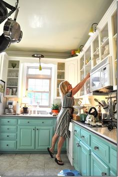 Two toned kitchen; teal bottom cabinets. My 1st house had an aqua cabinet color called Seafoam. The original 1952 stickers were still on the inside! I loved that kitchen beyond reason. This teal is a little darker but close enough to make me smile!