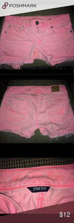 Bright Pink American Eagle Shorts These bright pink shorts are so pretty and will look great for this summer! Size 00. They do have a small stain under the leg which is not noticeable when wearing. Have not tried to get it out so it may be removable. Thanks for looking! American Eagle Outfitters Shorts Jean Shorts