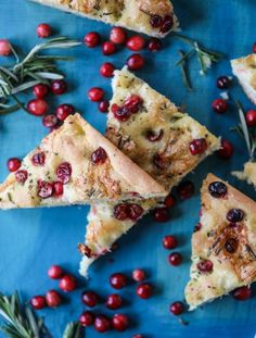 This focaccia bread recipe is perfect for the holidays - it's studded with fresh cranberries, melted brie cheese and chopped rosemary.