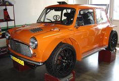 "Mini based on a race-ready Opel Astra. The extended body of an ""old style"" Mini was fitted with the suspension and drivetrain of the Astra: a 2.0 rally block linked to a sequential six-speed gearbox. All this is good for 260 horses in a 700 kg car, which means with 2.7 kg / hp a better power-to-weight ratio. The rear wing of a Williams F1 car was mounted to ensure that the whole does not fly too high. The car was also decorated with 18 ″ light metal and an adequate braking system."