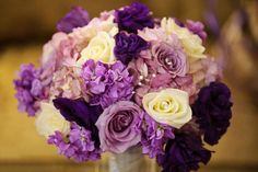 Purple and Ivory wedding bouquet. Roses, carnations, hydrangeas.