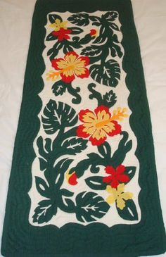 Hawaiian quilt table runner 100% hand quilted/hand appliqued Hawaiiana by Hawaiian Quilts & Gifts. $59.95. 100% Brand New Hawaiian Handmade Table Runner / Wall Hanging 20x50. It has 3 loops in the back where you can insert a rod for easy hanging. 100% Hand Quilted and 100% Hand Appliqued. There's a count of 6-8 stitches in an inch. Multi Red Hibiscus Design. ALOHA, this quilt is made of 65% Polyester and 35% Cotton.  Which makes the quilt 100% machine washable.  We ...