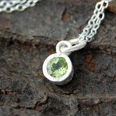 Peridot Dot Sterling Silver Necklace - A stunningly simple and elegant pendant featuring a single peridot semi precious stone in a naturally textured sterling silver setting. #Embersjewellery #Jewellery #August #Birthstone #Peridot