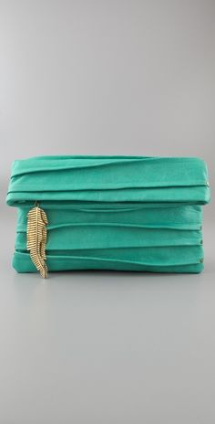 "I ADORE this color. Picturing it with camel and other neutral colors...    Cleobella ""Wenona"" Clutch. $260. Shopbop.com"