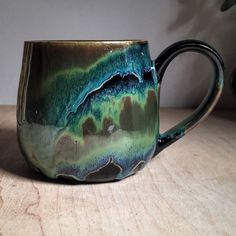 Love this glaze idea! Bands of Obsidian and Seaweed on buff stoneware fired to cone 6 by Amanda Joy Wells Pottery Mugs, Ceramic Pottery, Glazes For Pottery, Ceramic Cups, Ceramic Art, Keramik Design, Ceramic Glaze Recipes, Amaco Glazes, Pottery Classes