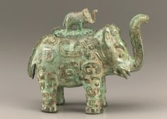 Chinese Art | Lidded ritual ewer (huo) in the form of an elephant with masks and dragons | F1936.6a-b