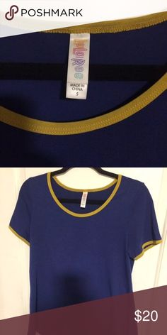 Small classic T This deep blue classic t has  gold trim. The classic tea is in excellent condition. Cross posted. LuLaRoe Tops Tees - Short Sleeve