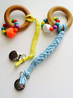 This is our Newest Product Our Teether and Shortie Pacifier Clip. Teether is actually 2 Teethers! The Wooden Ring and the Silico. Teething Jewelry, Teething Beads, Diy Bebe, Handmade Baby Gifts, Dummy Clips, Baby Gym, Baby Teethers, Wooden Rings, Natural Baby