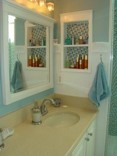 Master Bathroom Remodel, Sophisticated, contemporary Master Bathroom with a little bit of sparkle! The focal point is the shower with blue mosiac tile and a new glass door enclosure. Wanescoting and teal walls add to the beach feel. And new sand countertops speak to the new tan tile floor.  A separate vanity area and private corner finish off this Master Bath. Heavenly and a dream come true!, Detail photo of shelving with blue glass mosiac tile lining the back wall.    , Bathrooms Design
