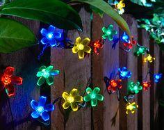 Buy Blossom String Lights From Kleeneze. Your online shop for OutdoorLighting Solar Lights, Fairy Lights, Colorful Garden, Garden Ornaments, Garden Accessories, String Lights, Outdoor Lighting, Our Wedding, Christmas Wreaths
