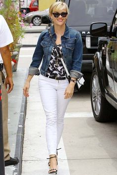 No wonder Reese Witherspoon looks so pleased with herself - this slick little summer ensemble is the perfect combo for a late lunch in the city. White cropped jeans and a denim jacket are two must-own staples for the summer months. #streetstyle #citychic