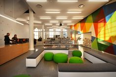 Teen Library Space. Benches are cool. The round chairs don't look comfortable to me.