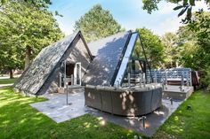 Uniquely styled, glass A-frame lodges with cool interiors and private hot tubs in Cornwall
