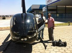 Filming for our special programme on Brazil - coming up on BBC World News on 22 September 2012. Rajan and Nick get ready for their helicopter's eye view of Brasilia. It's designed to look like a plane from above!
