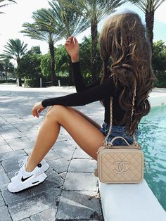white Nike tennis shoes + chanel bag